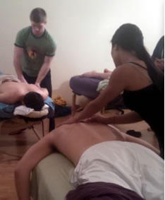 another photo of students giving massages